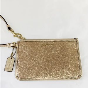 Coach gold wristlet with gold hardware Like New!